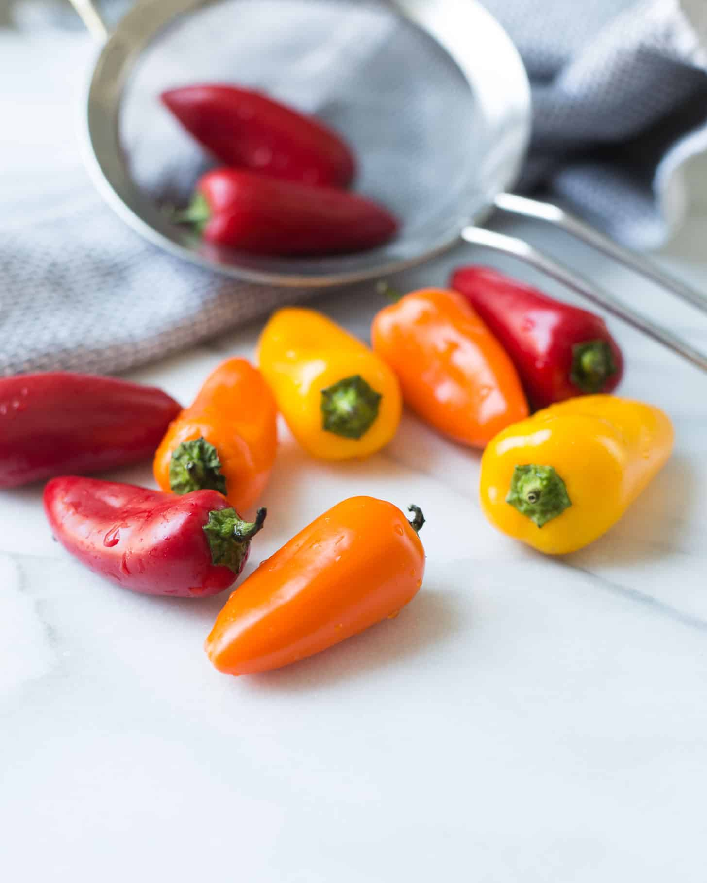 red, yellow and orange sweet peppers