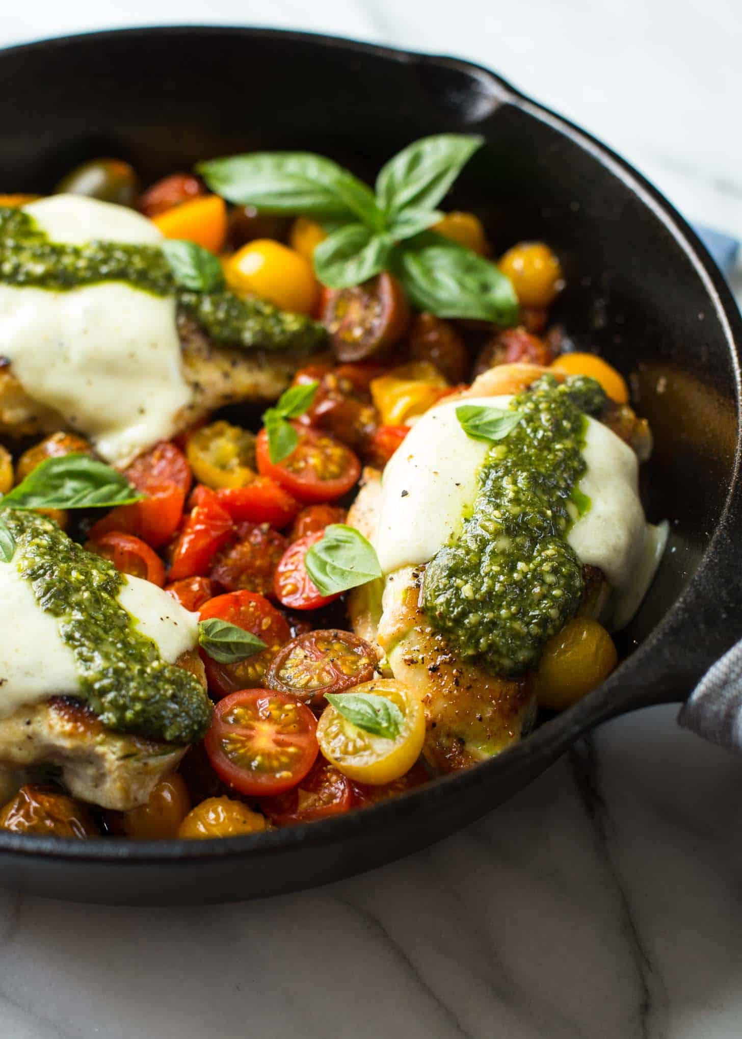 caprese chicken in a cast iron skillet