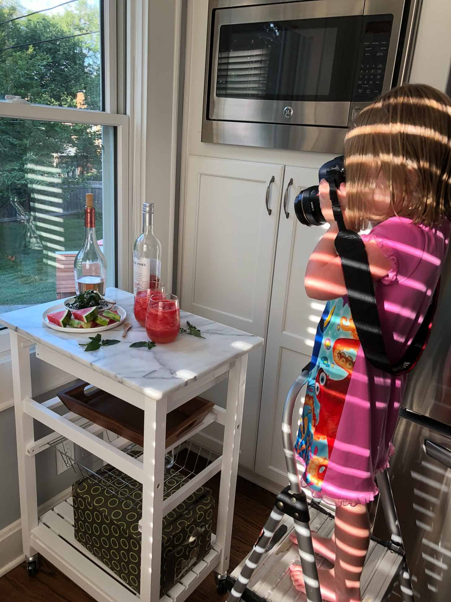 Clara taking pictures of a food display