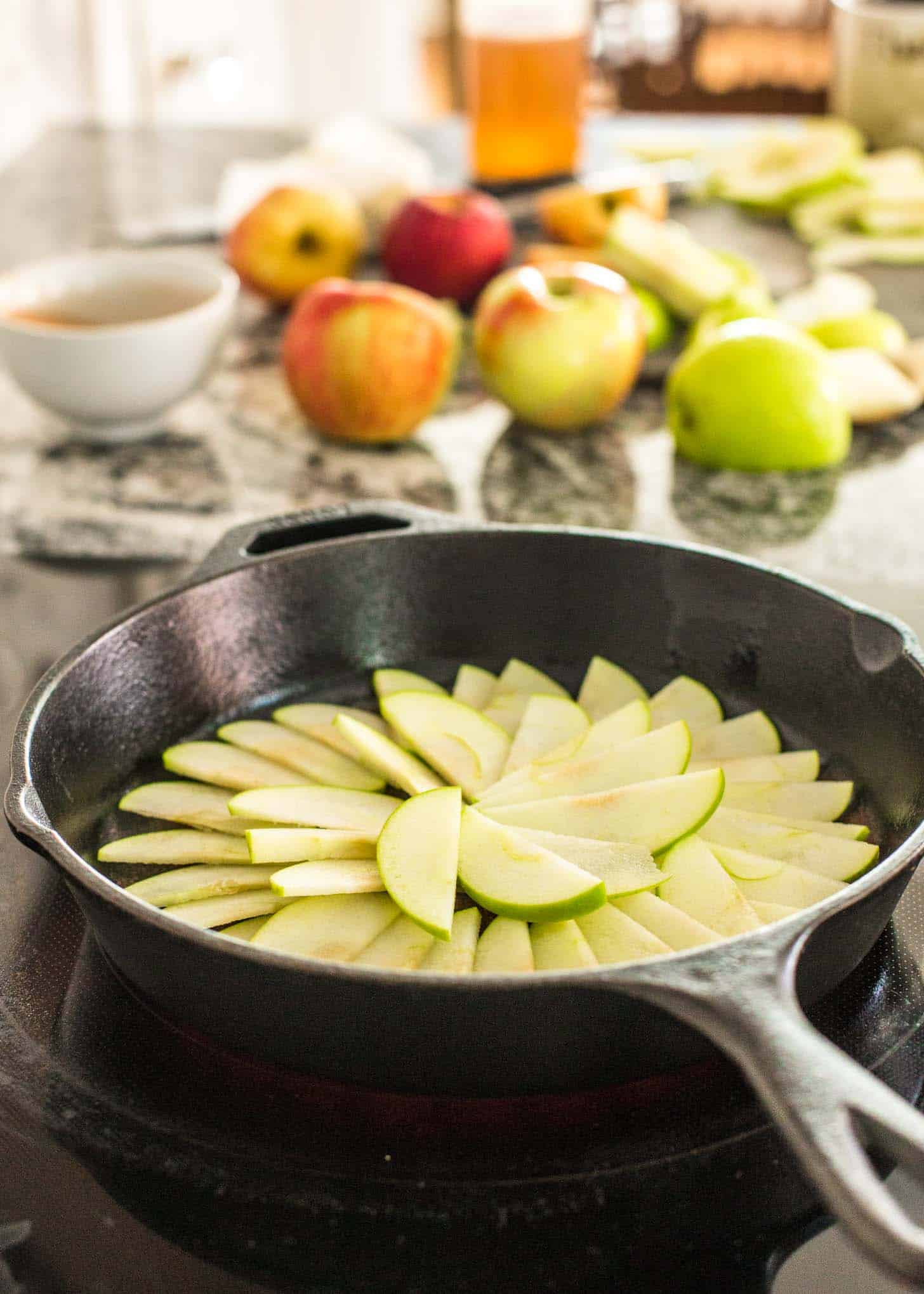 sliced green apple in a cast iron skillet