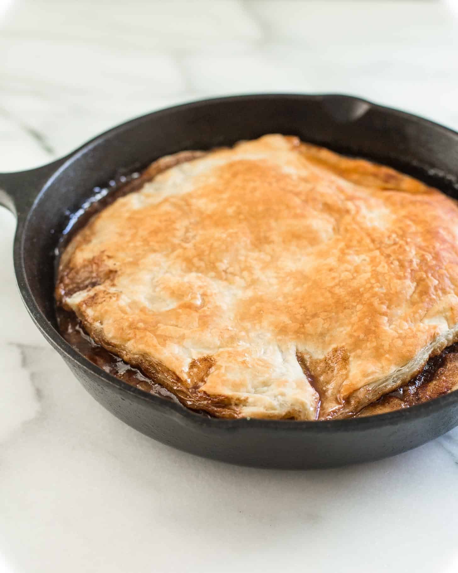 pastry topped apple tart in a cast iron skillet