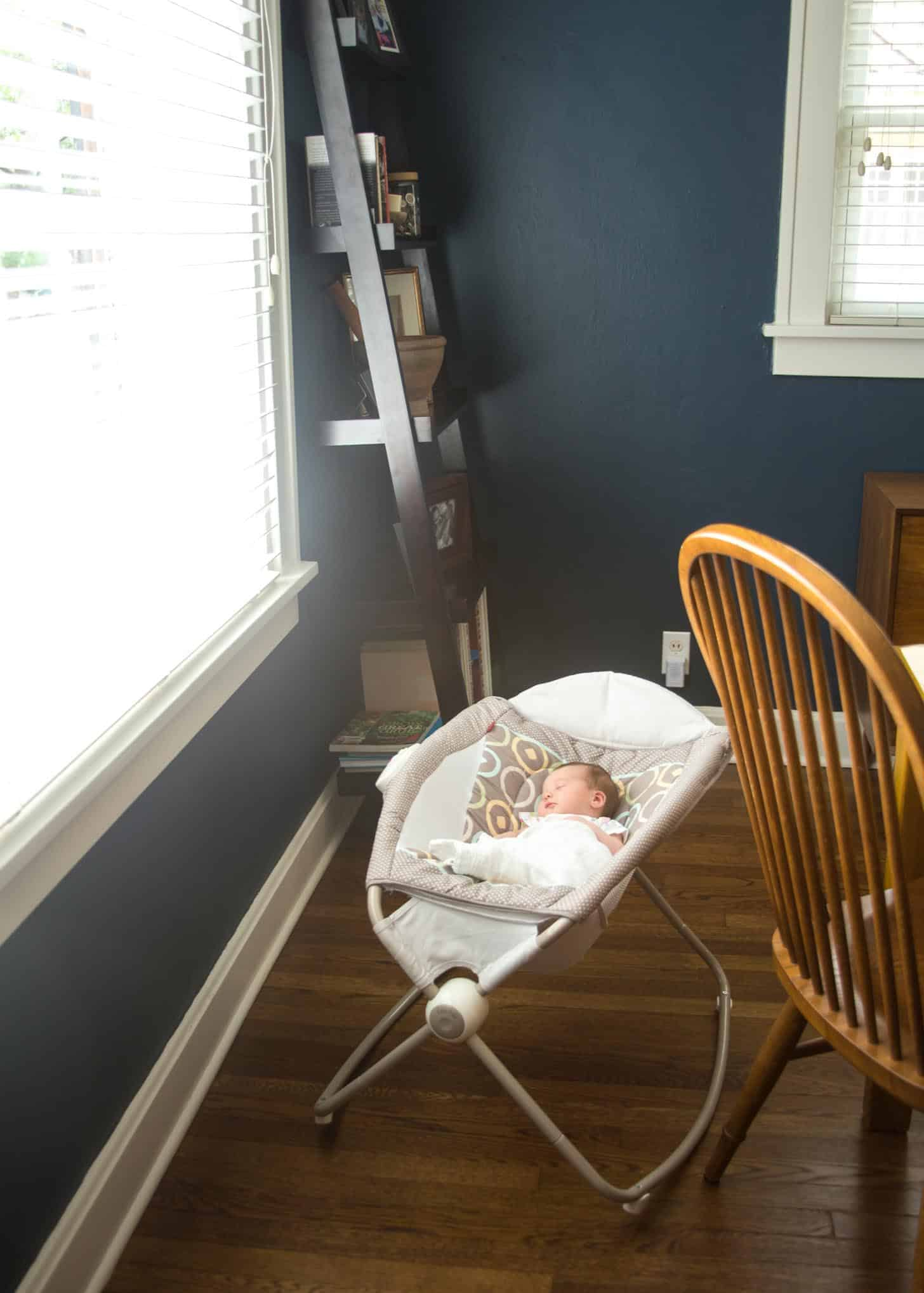 a baby sleeping in a swing
