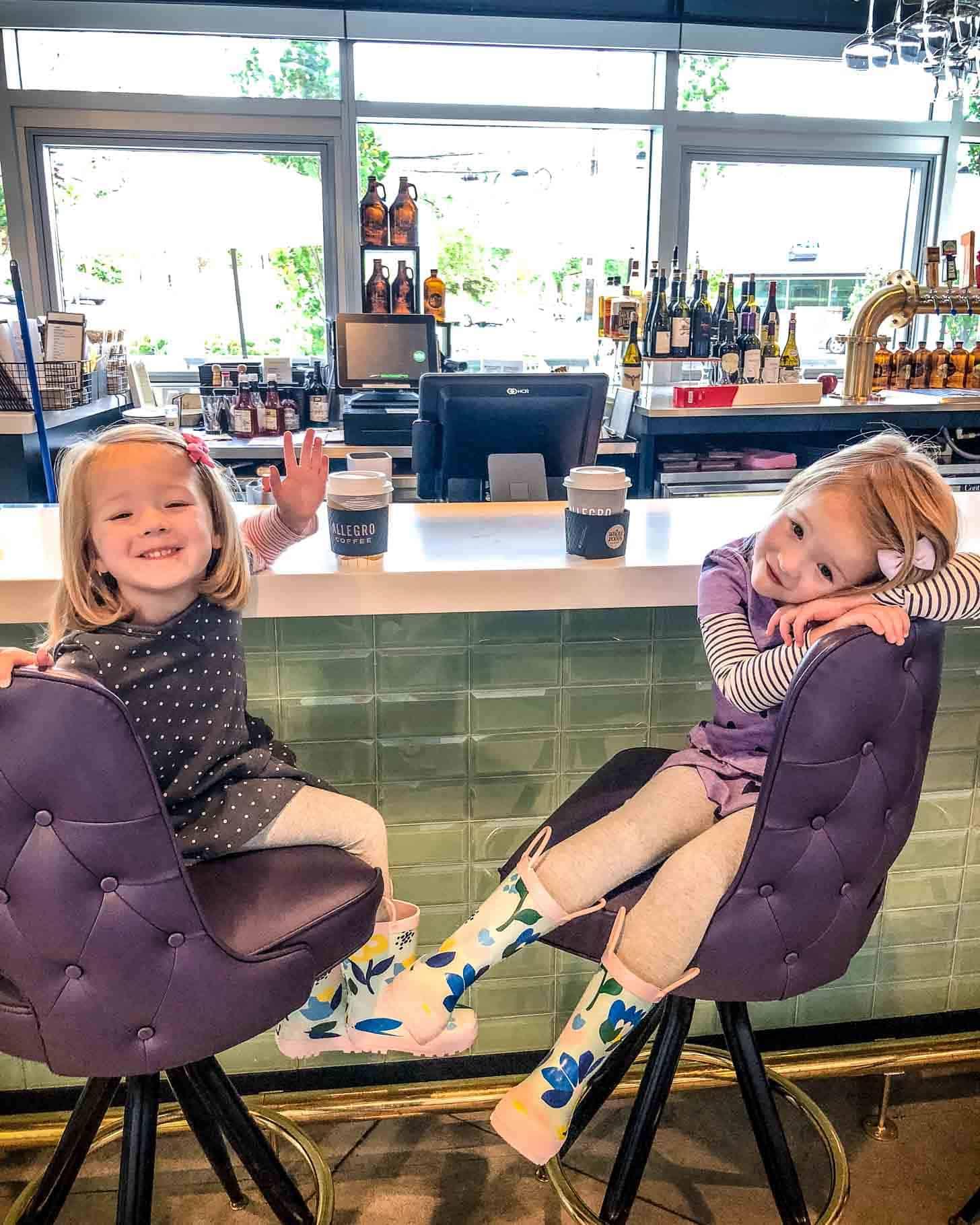 2 little girls having hot cocoa
