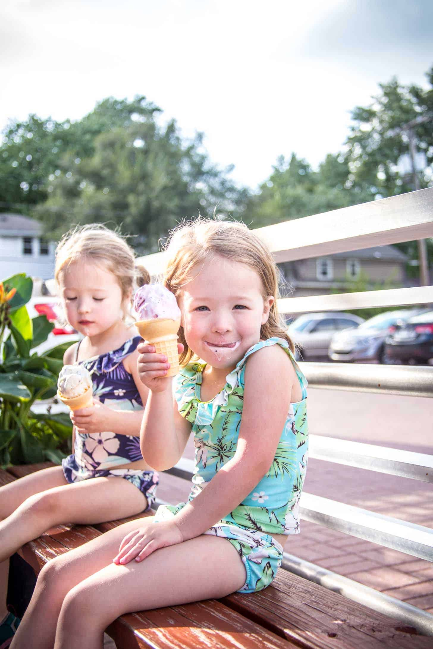 two little girls eating ice cream cones
