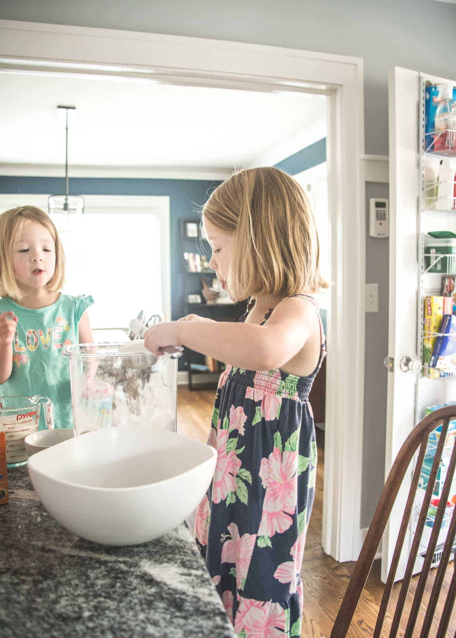 two little girls helping with baking