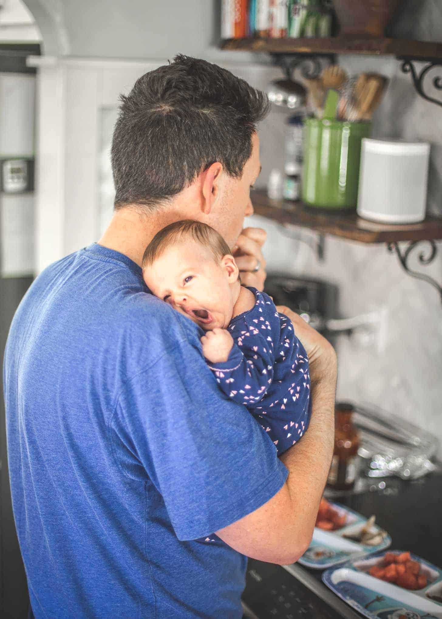 Frank holding baby June