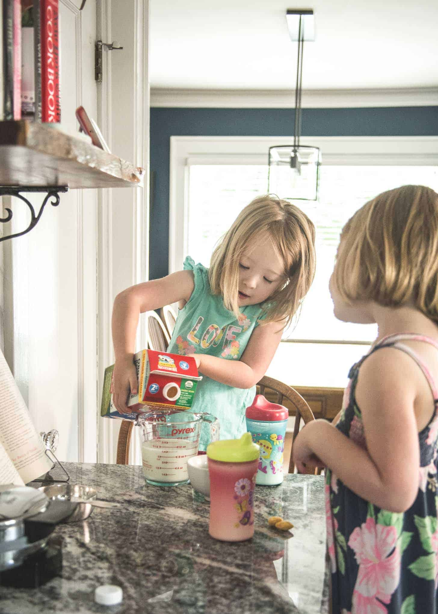 2 little girls helping with baking