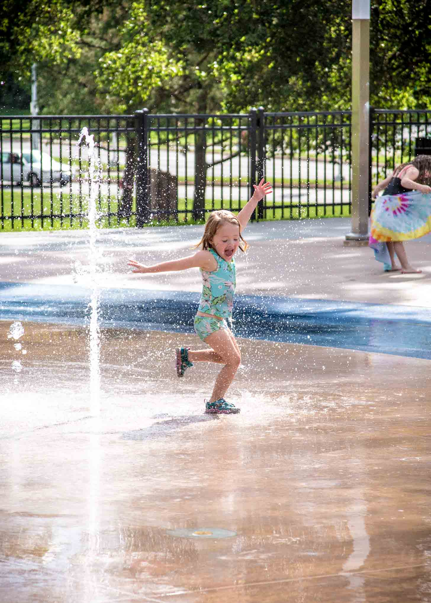 a little girl running through the water