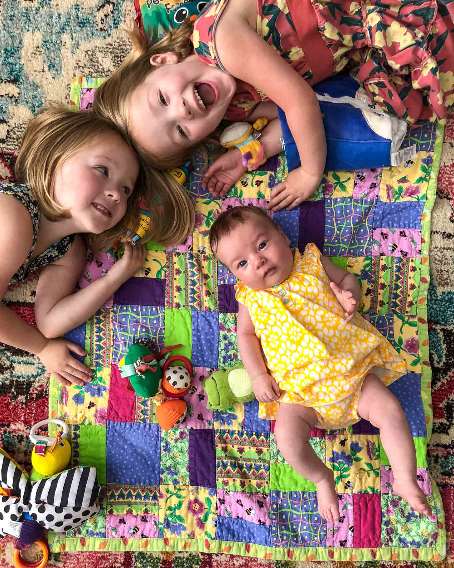 Molly, Clara and June on a play mat