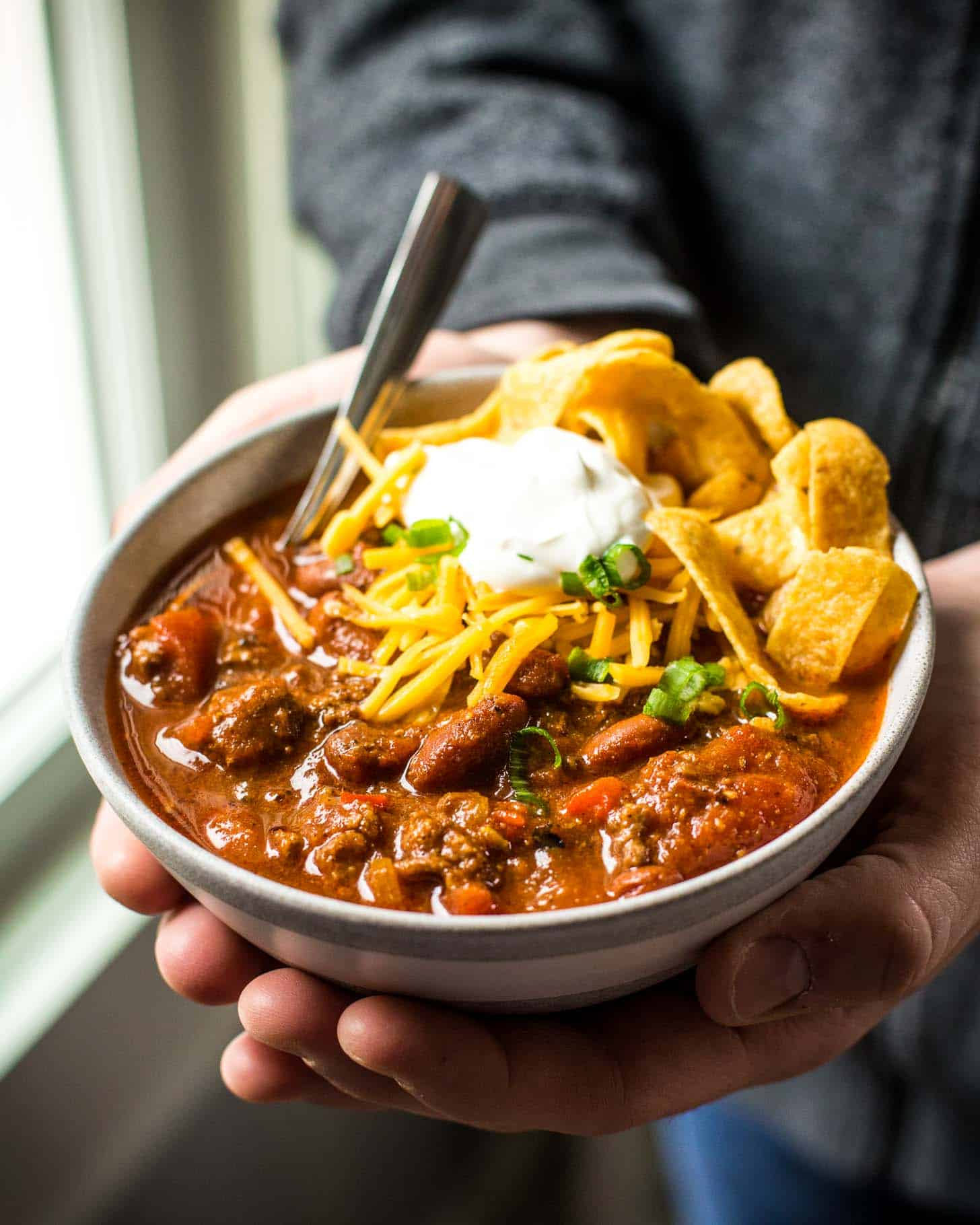a bowl of Chili with cheese and sour cream