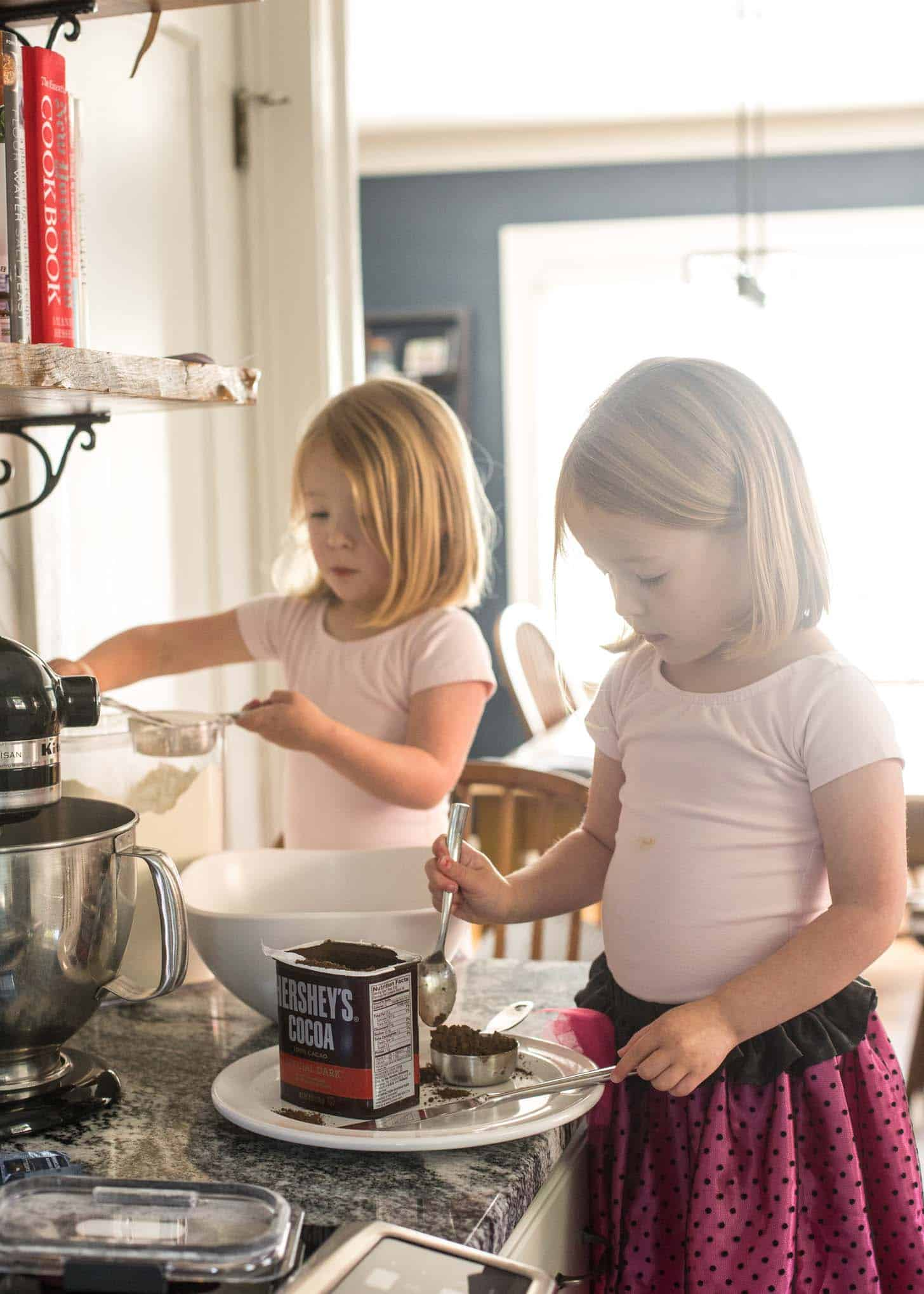 two little girls helping with baking cookies