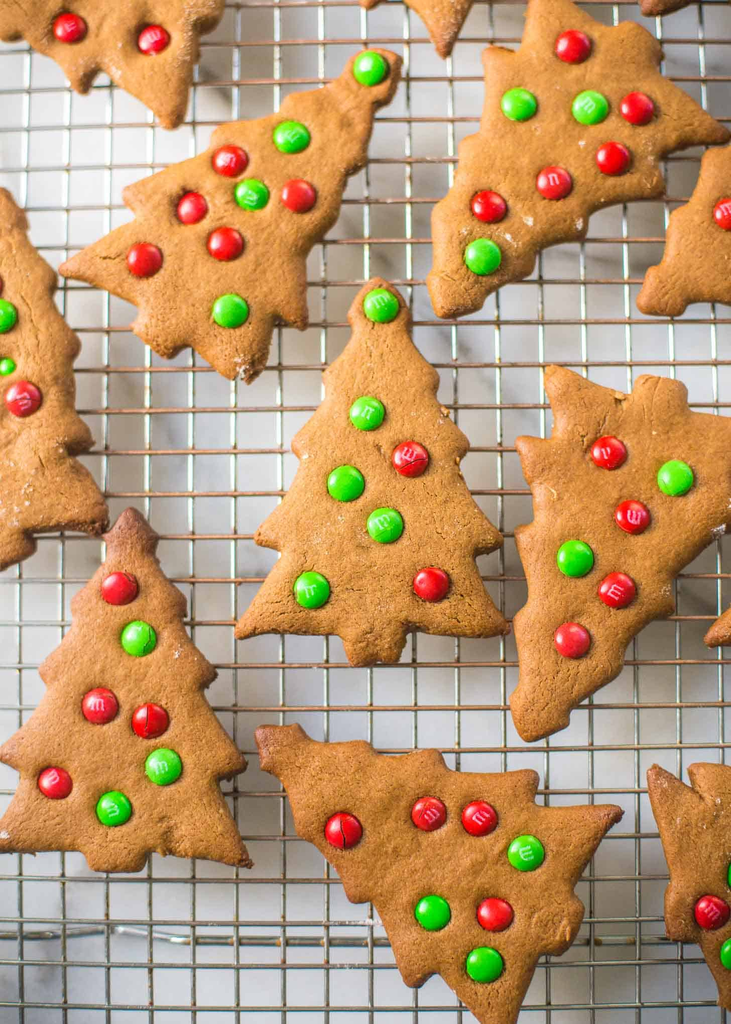 tree shaped Gingerbread Cookies on a cooling rack