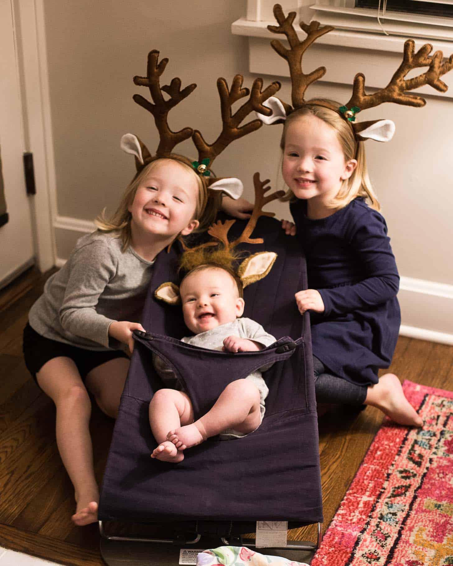 little girls in reindeer antlers