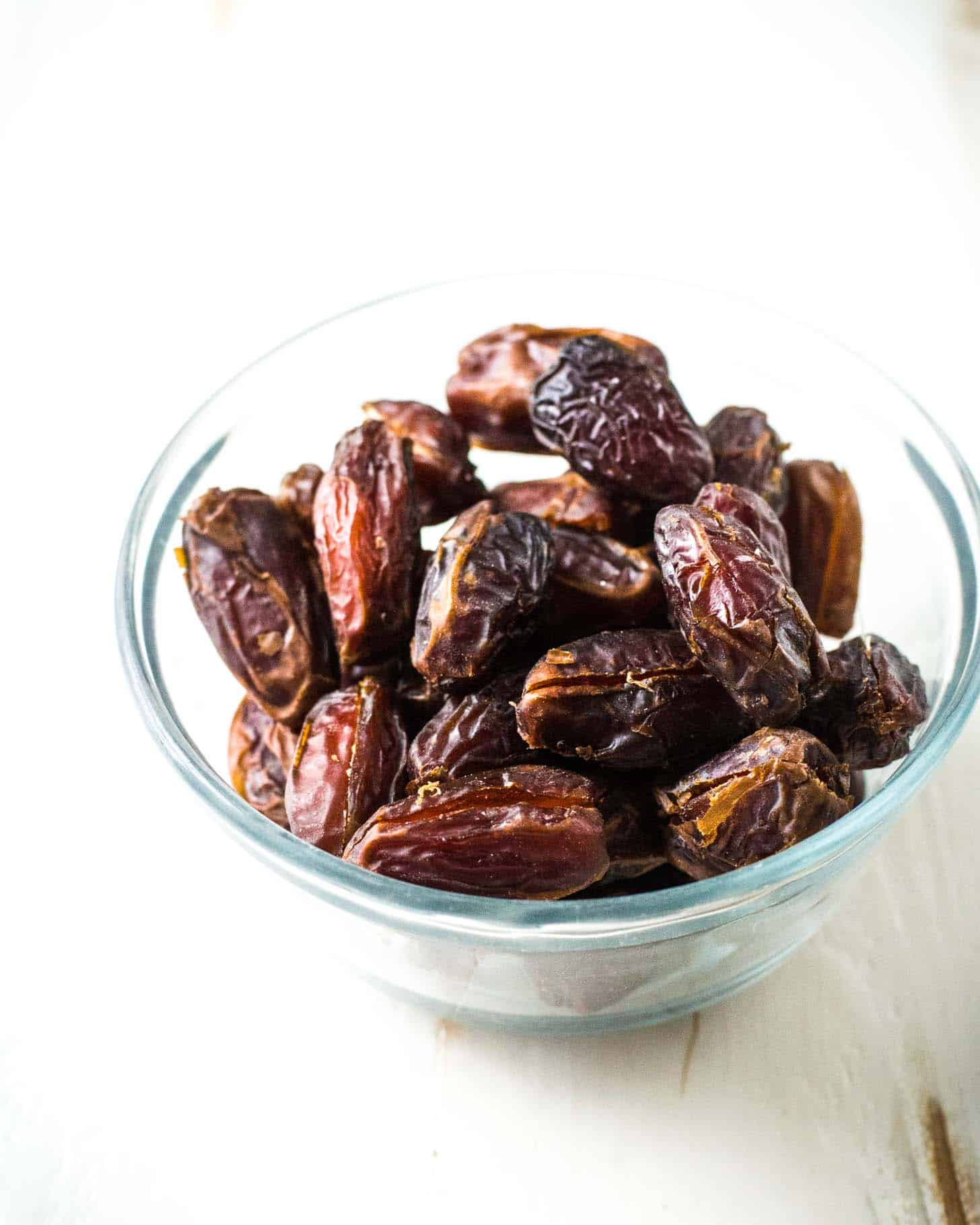 medjool dates in a clear bowl