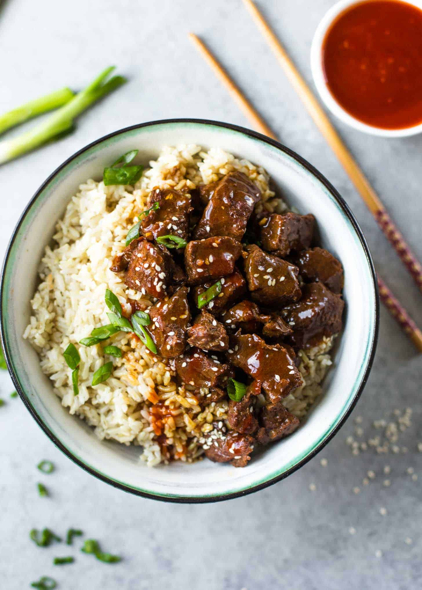 beef and rice in a white bowl