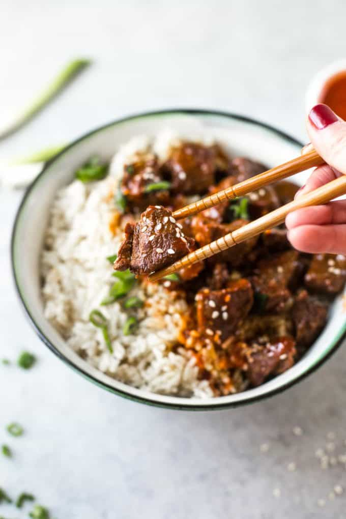 eating Korean Beef and Brown Rice with chopsticks