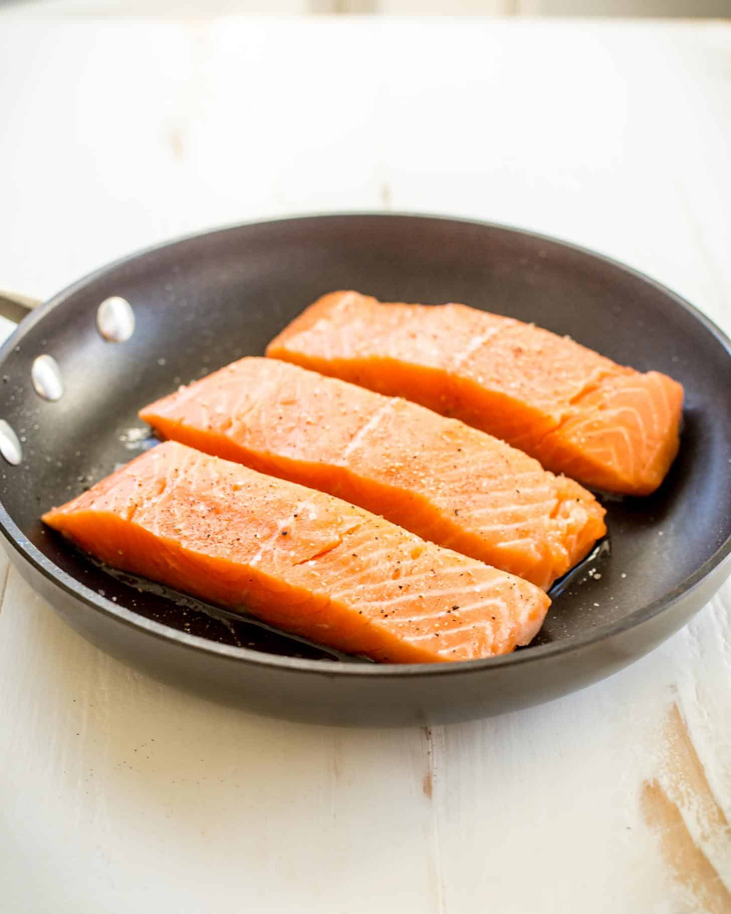 pan searing salmon in a non-stick skillet