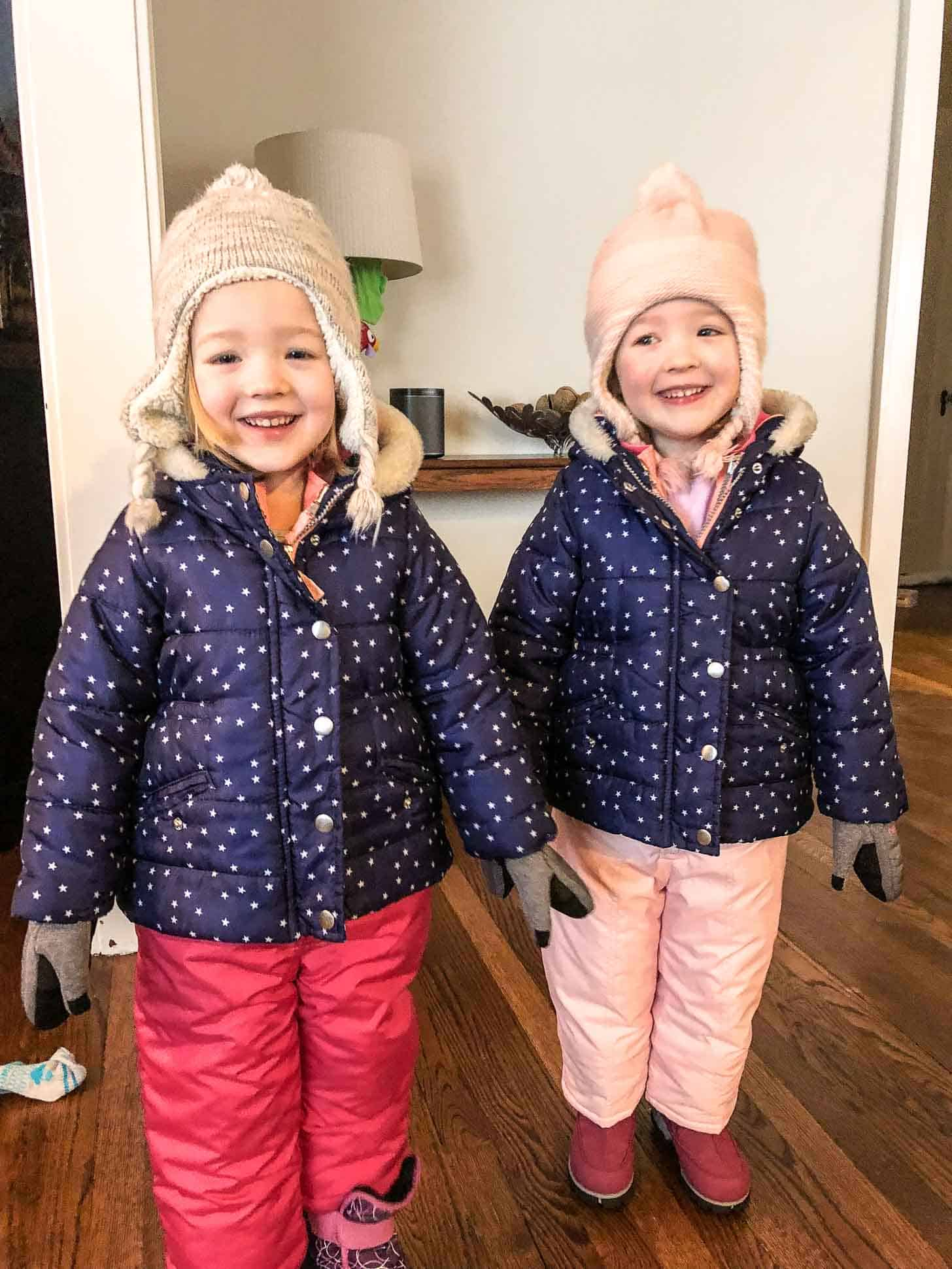 two little girls in snow gear