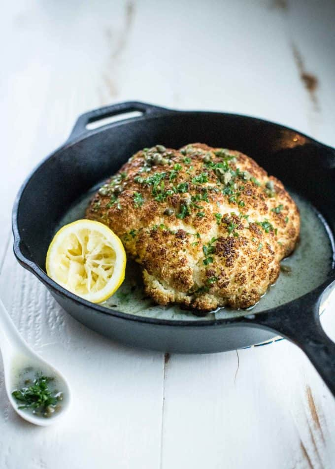 Whole Roasted Cauliflower in a skillet