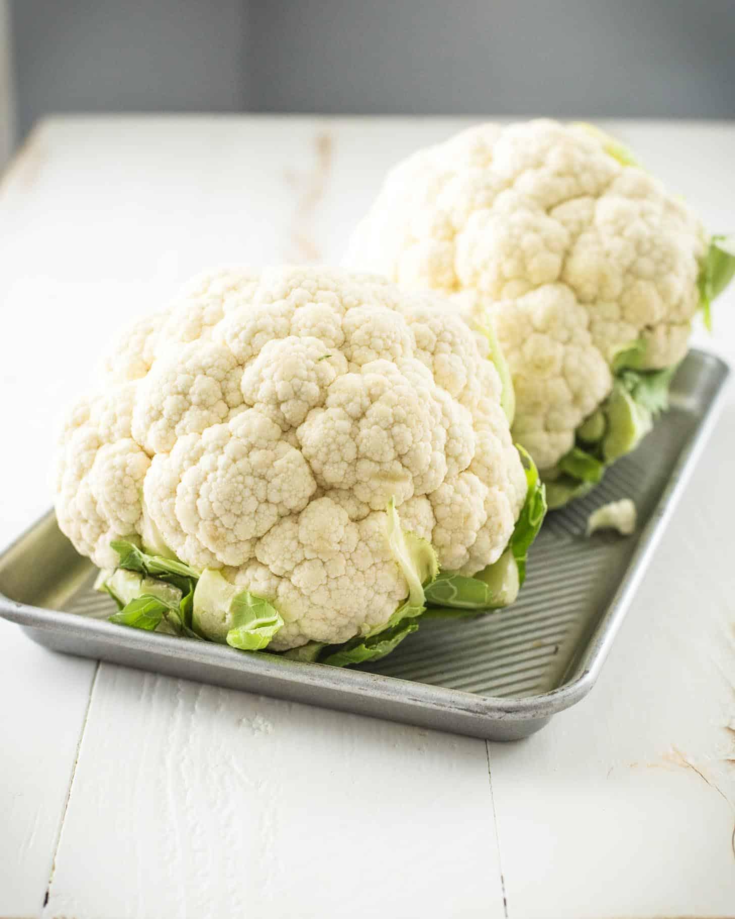 raw cauliflower on a sheet pan