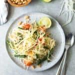 Green Papaya Salad on a white plate