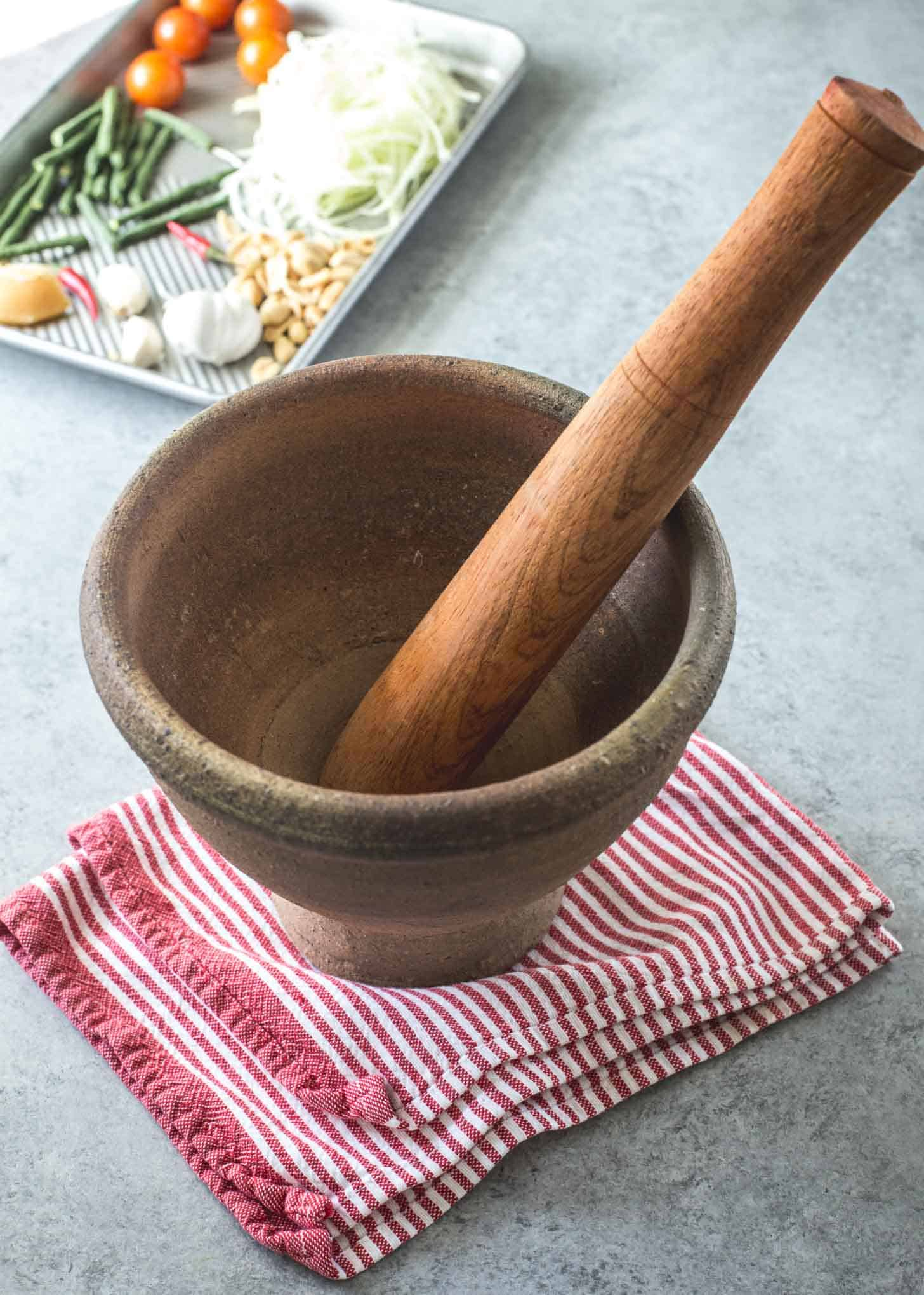 Thai mortar and pestle on a white table