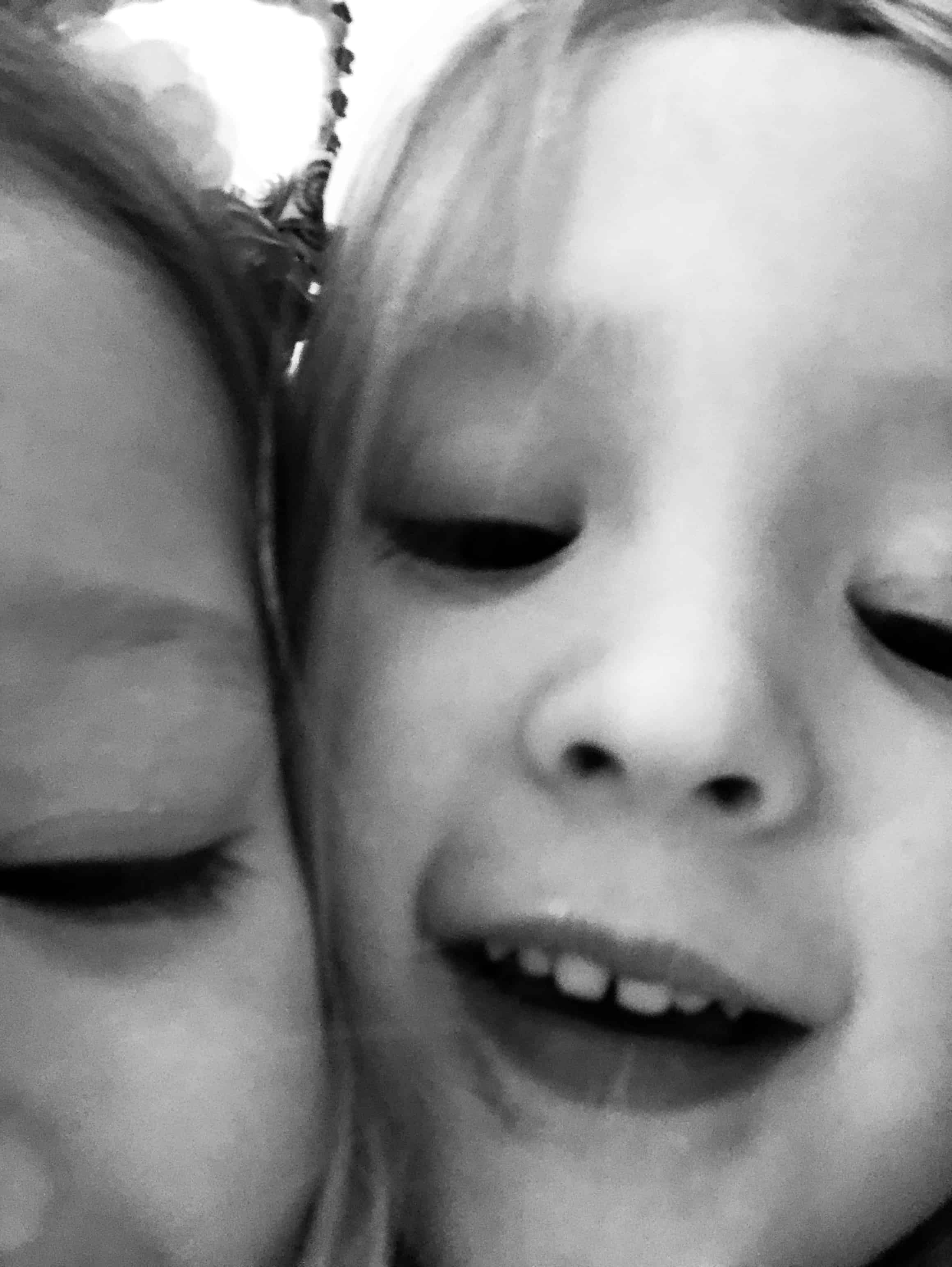 black and white selfie of two little girls
