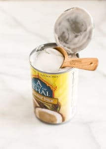 Can of coconut milk with a spoon showing the amazing texture
