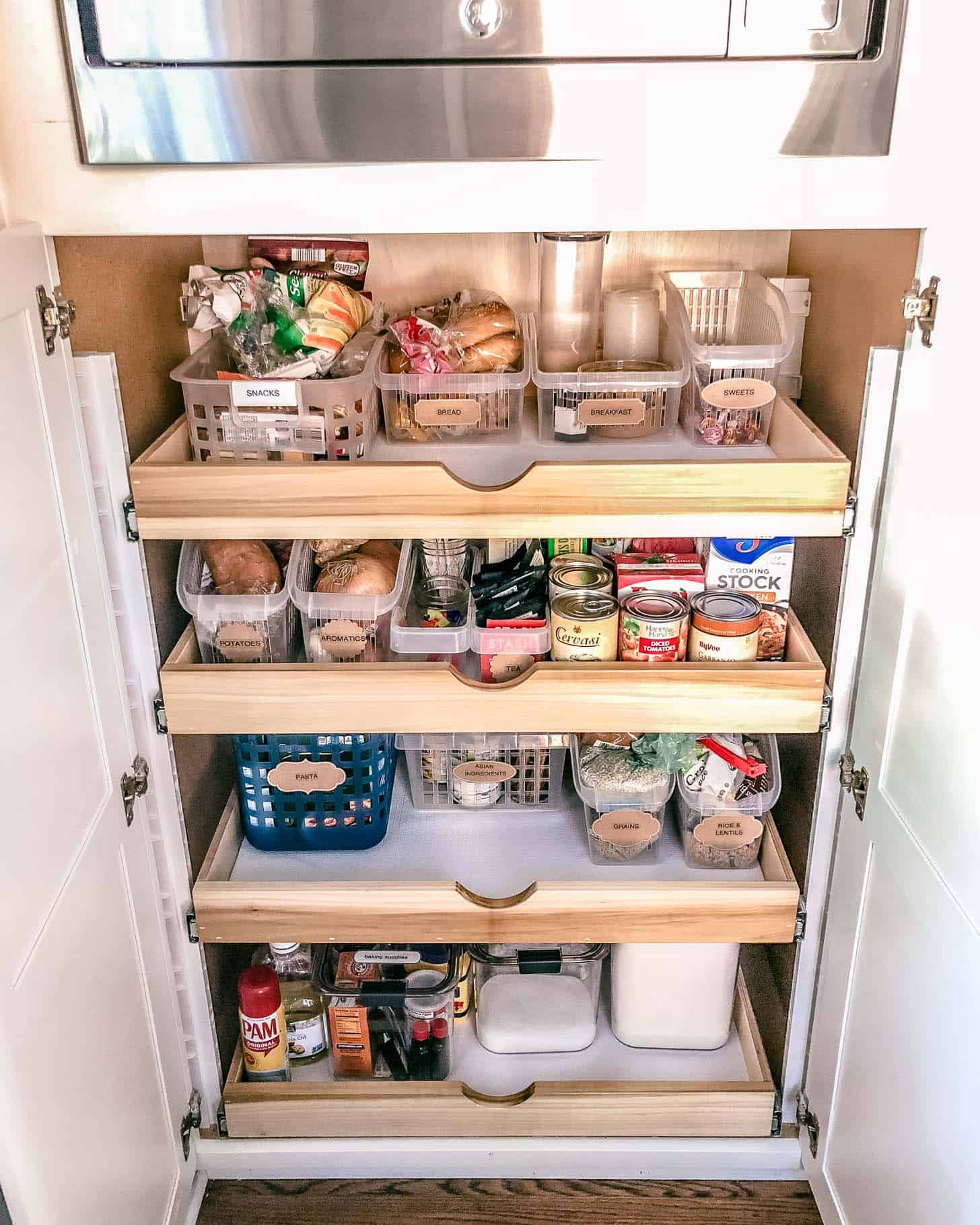 an open pantry with pull out drawers