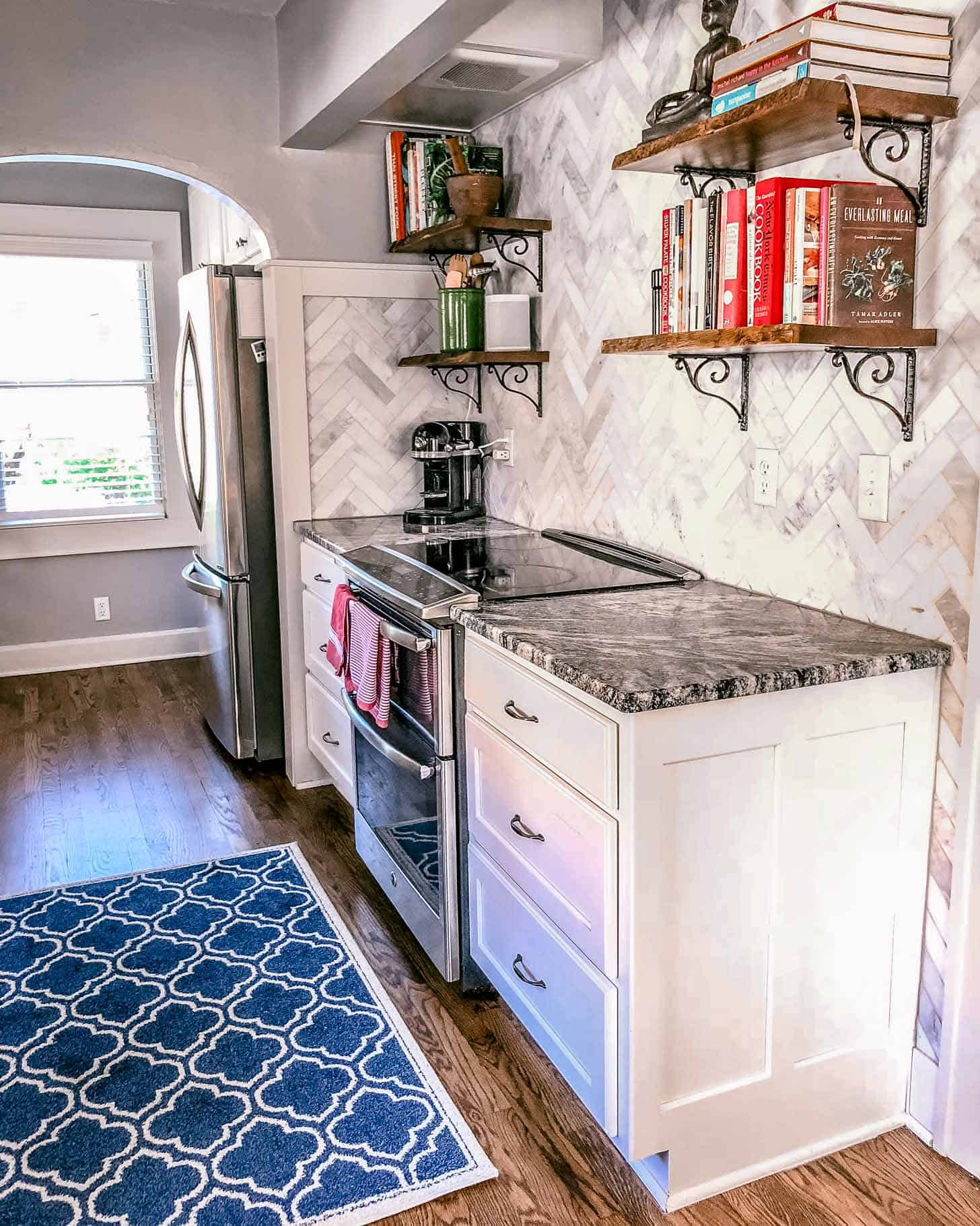 stove and cabinets in a white kitchen