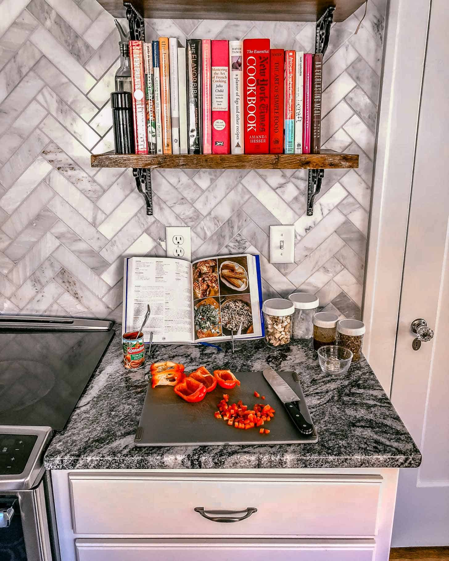 a cutting board on a grey countertop