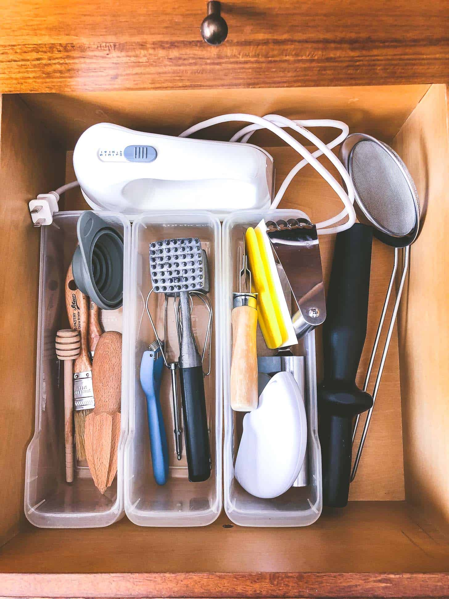a drawer with utensils and tools