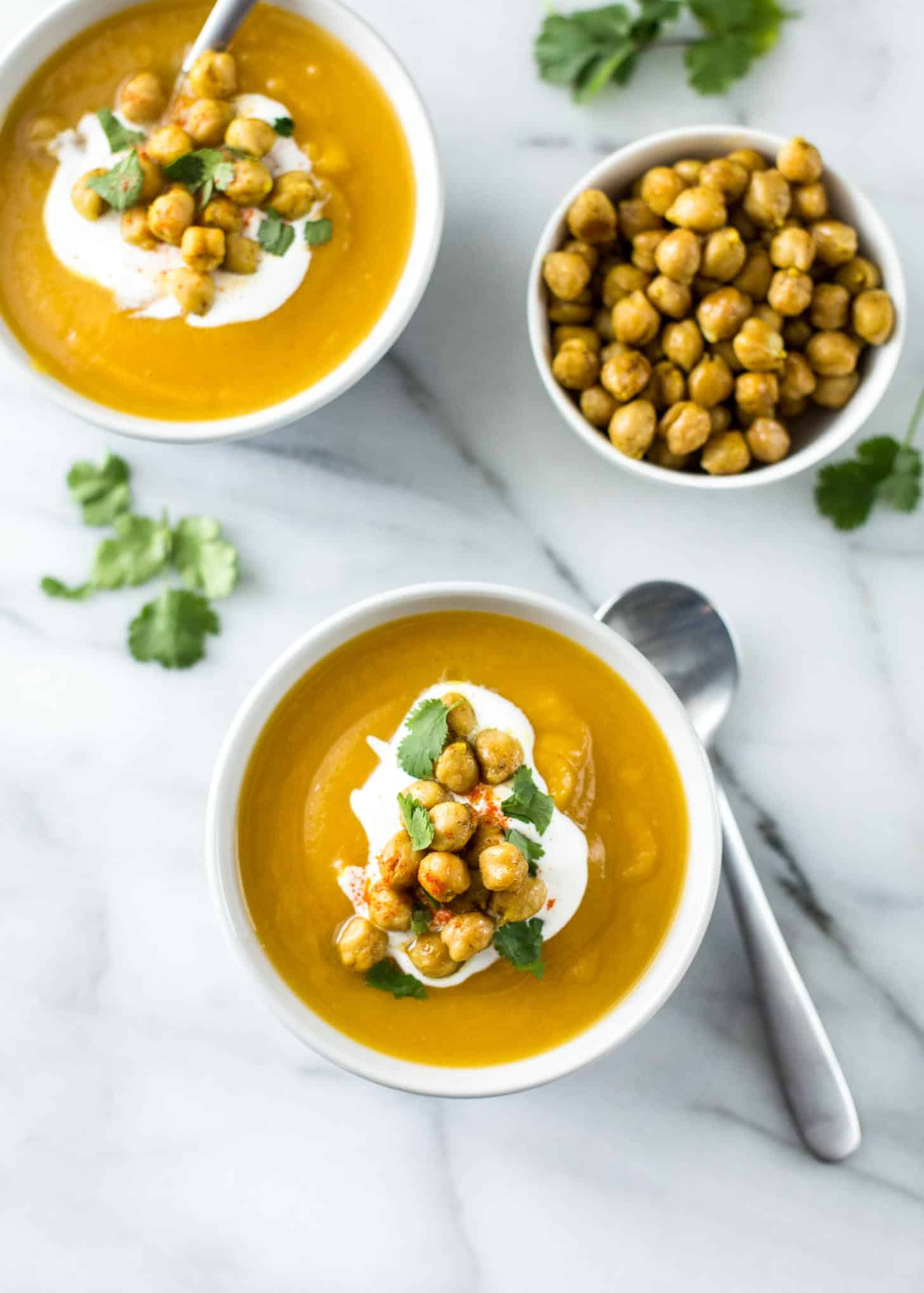 2 bowls of Sweet Potato Soup topped with sour cream
