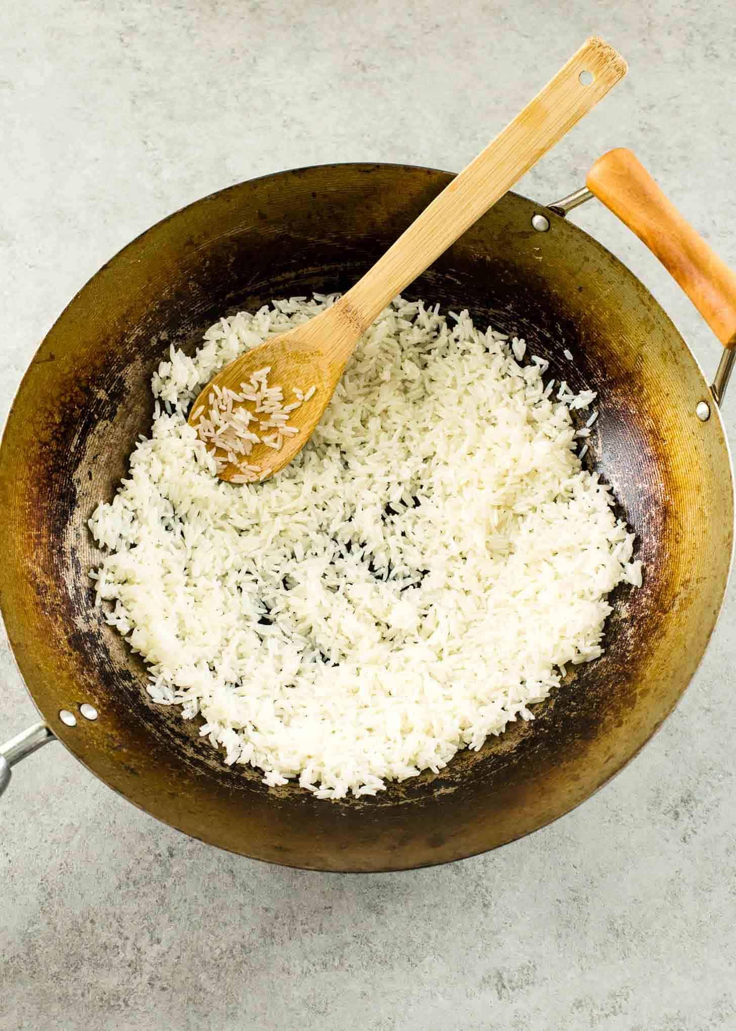 stirring Thai Crispy Rice in wok