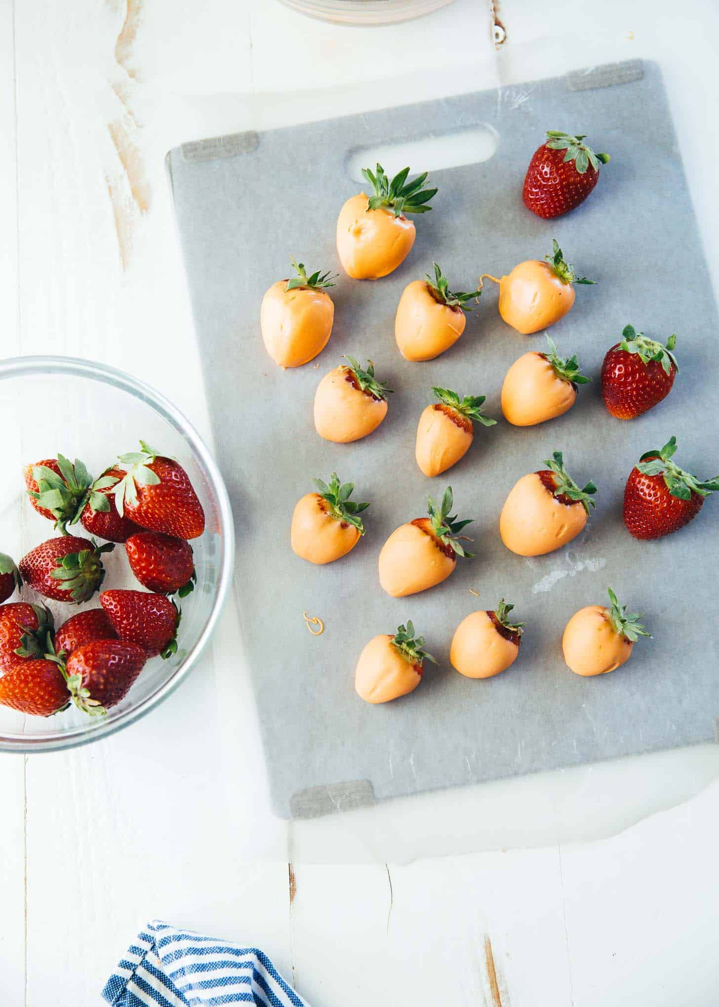 dipped strawberries on a cutting board