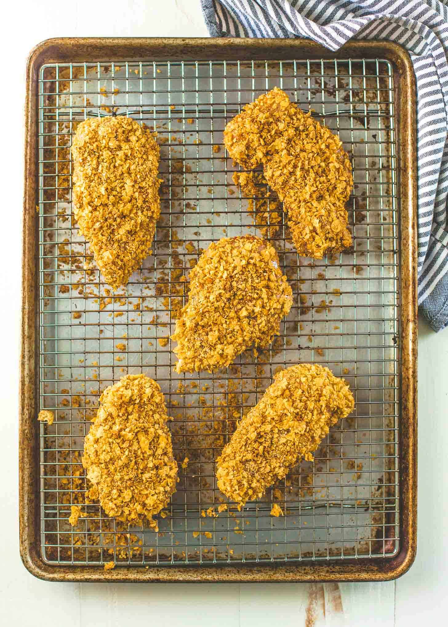 Crispy Baked Cornflake Chicken on a sheet pan