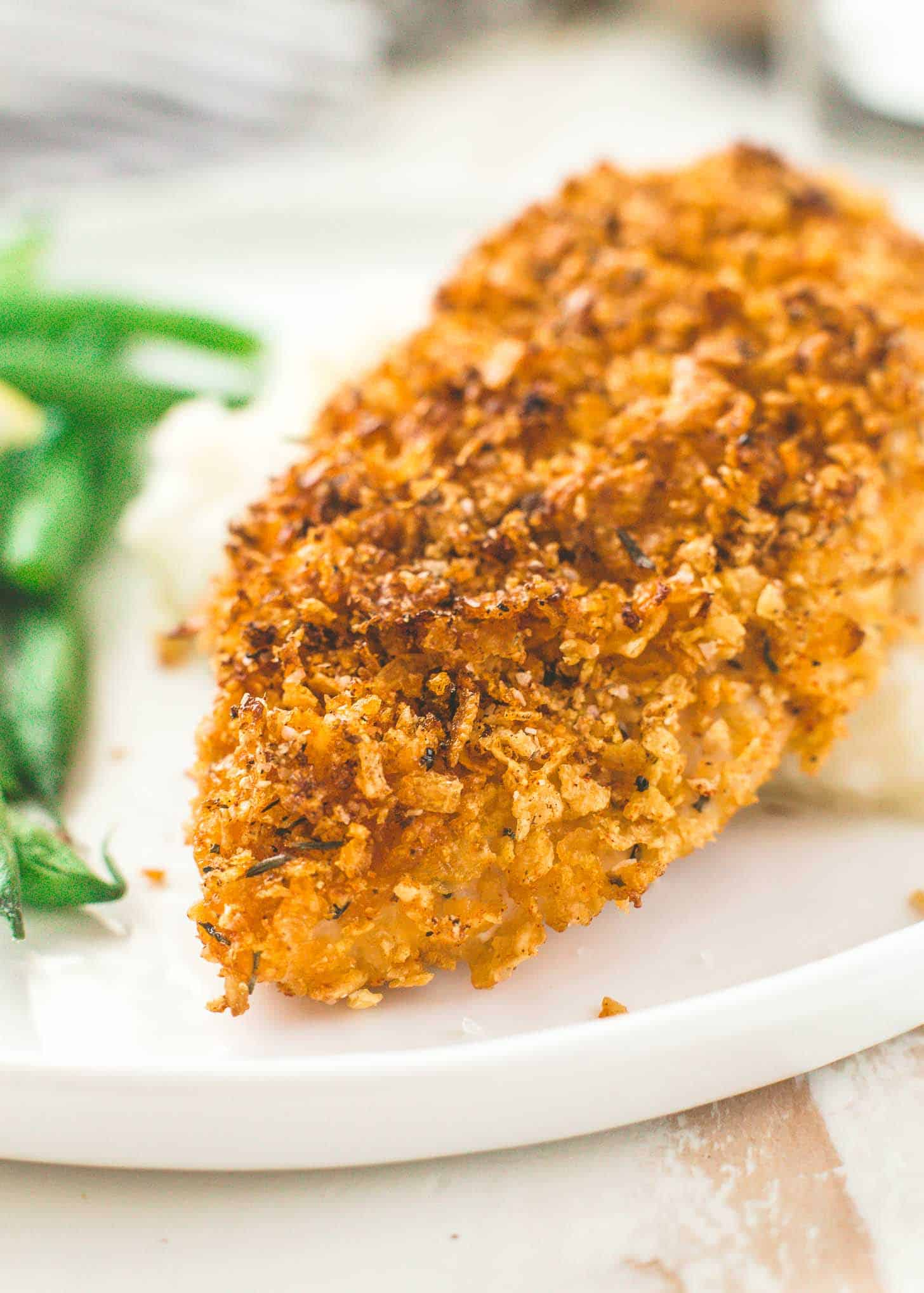 Crispy Baked Cornflake Chicken on a white plate