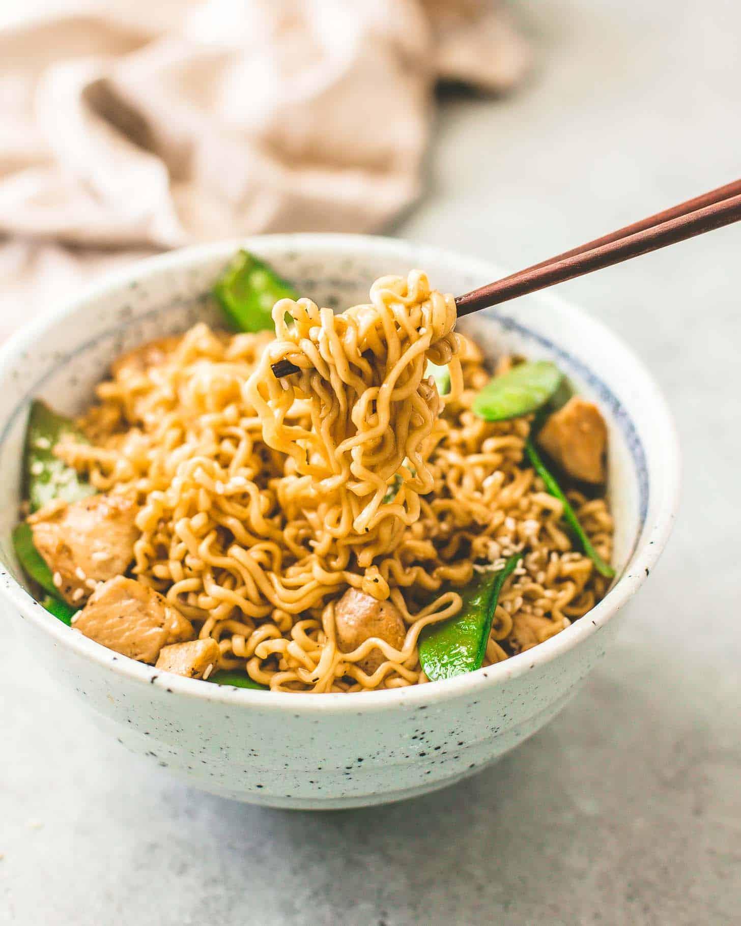 Sesame Garlic Ramen Stir-Fry in a bowl ready to eat with chopsticks
