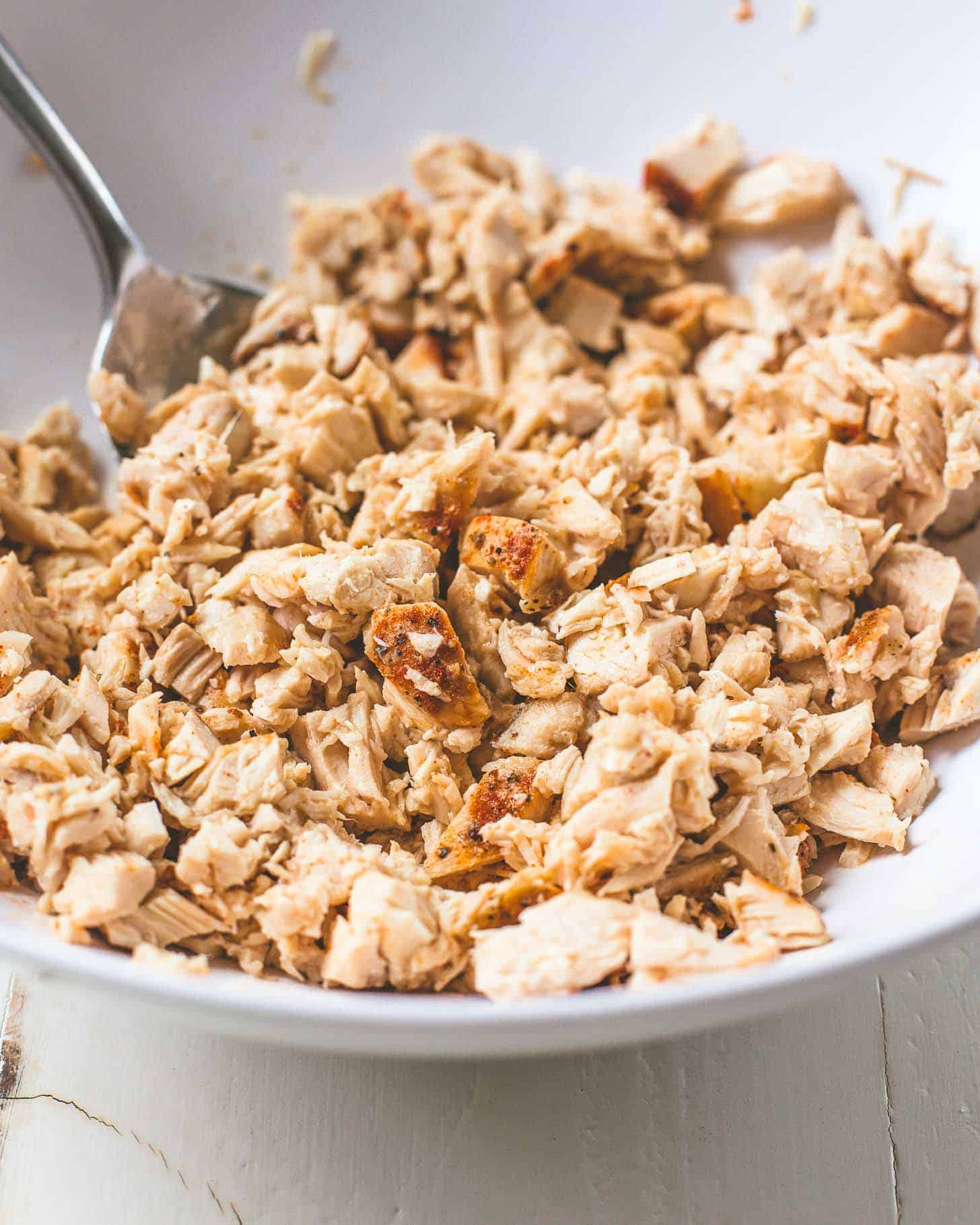 cooked chicken in a white bowl