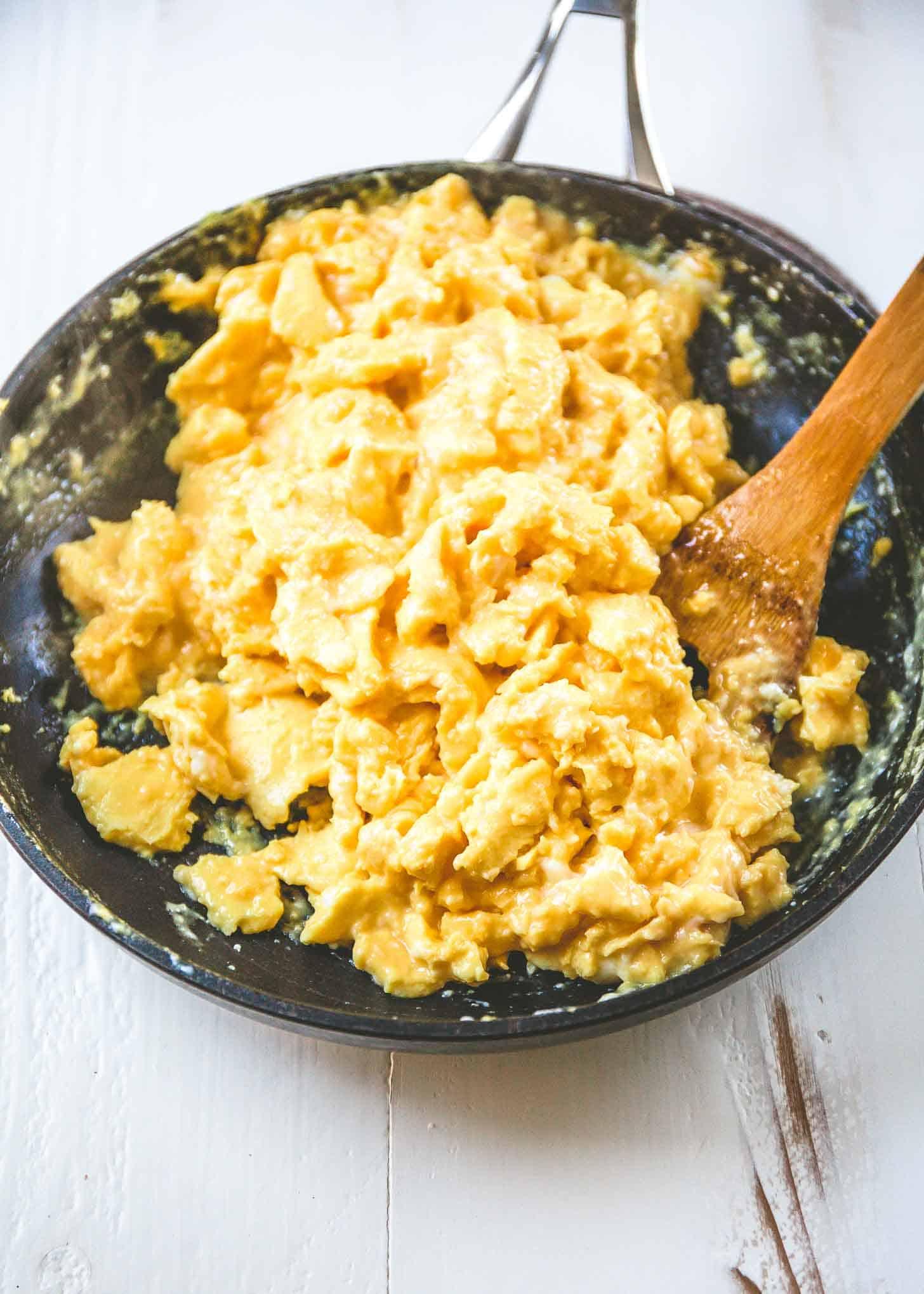 scrambling eggs in a skillet