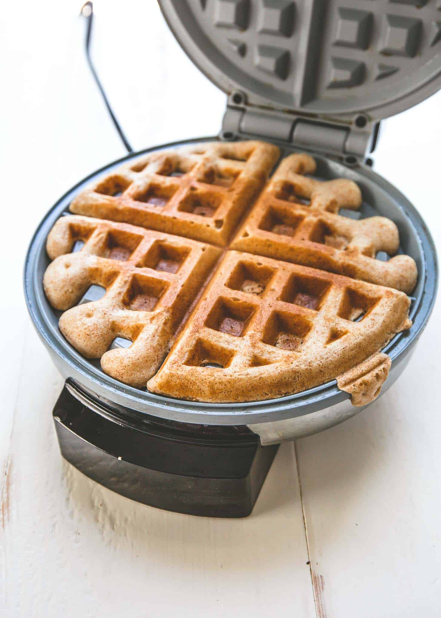 making a waffle in a waffle maker