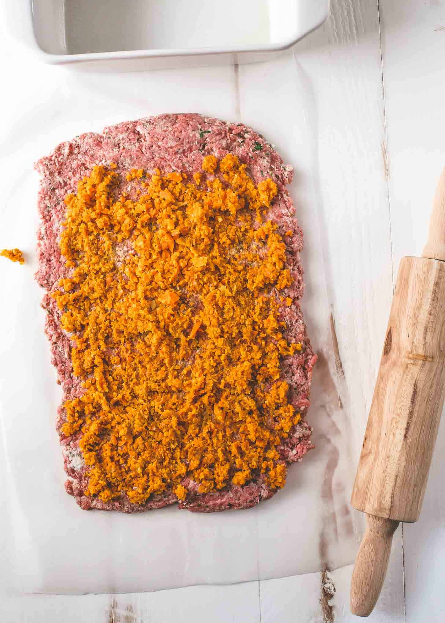 spreading carrot mixture over meatloaf