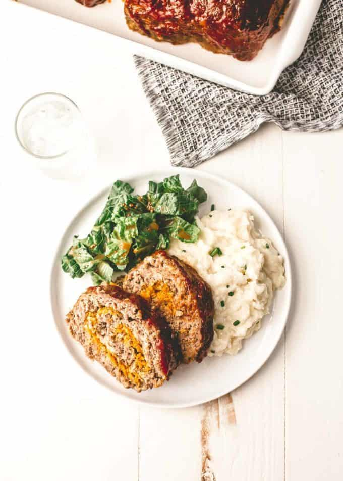 Classic Meatloaf on white plate with mashed potatoes