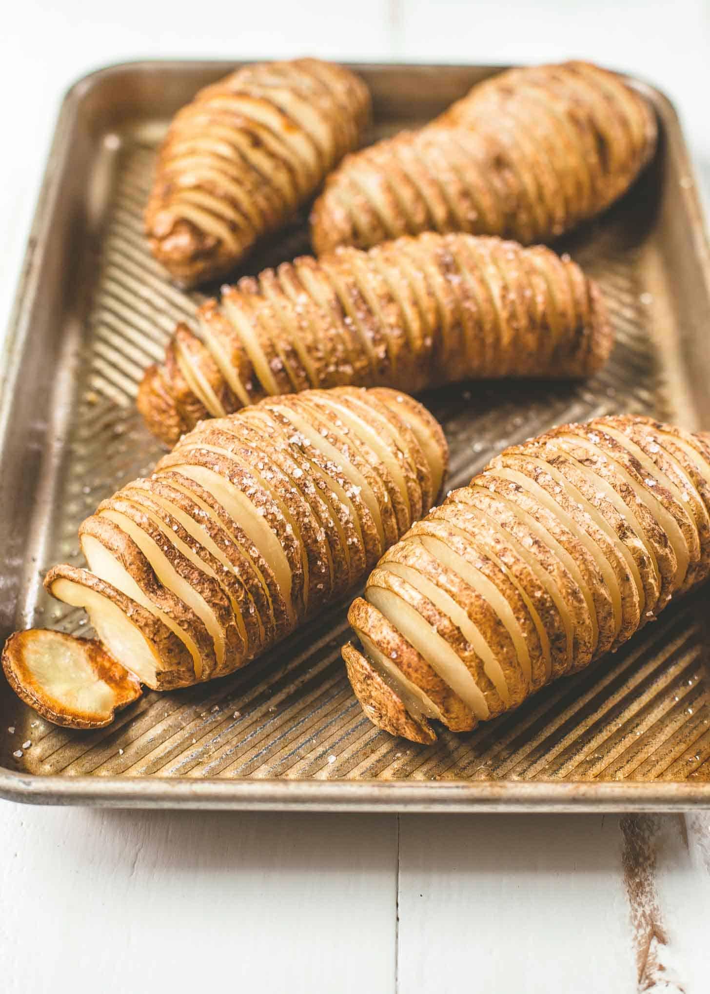 hasselback sliced potatoes on a sheet pan