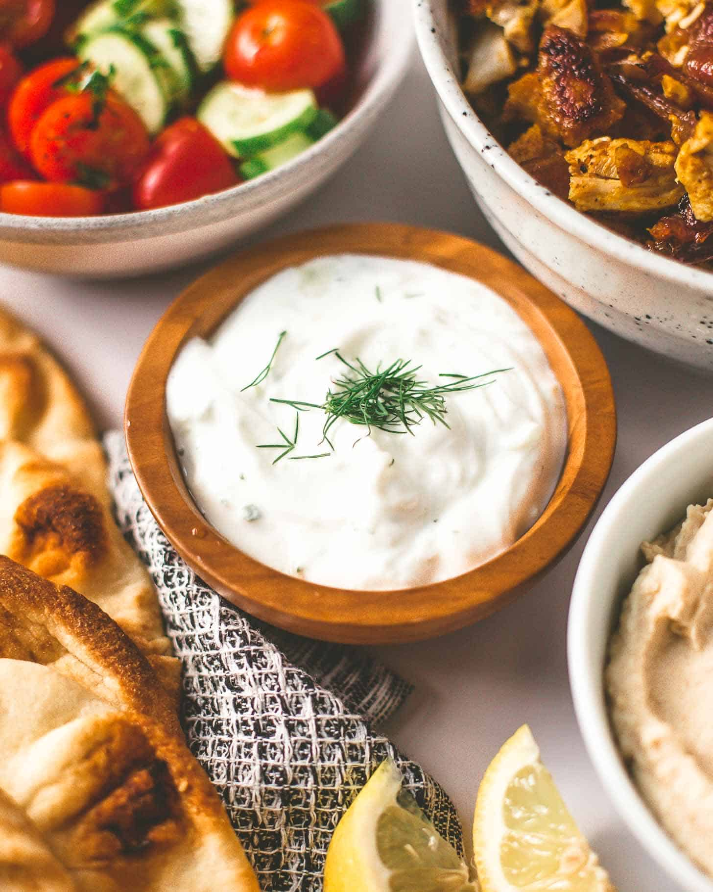 tzatziki sauce in a small wooden bowl