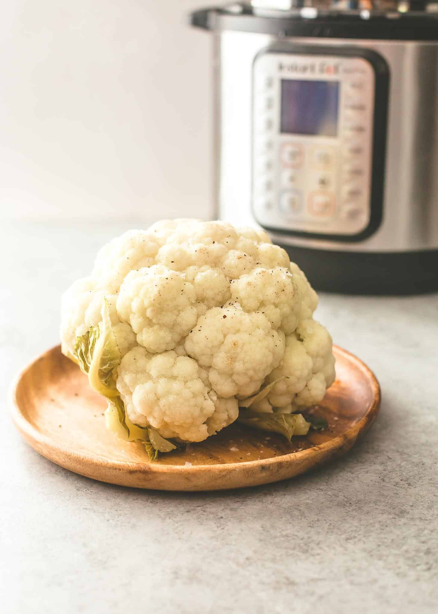 steamed cauliflower on a wooden tray