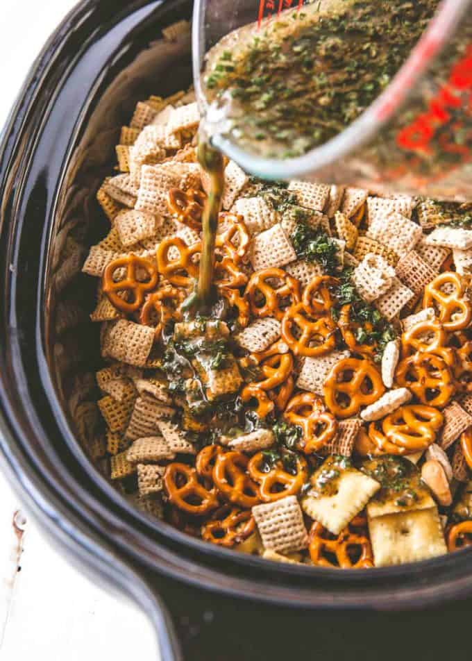 adding spices to party mix in the slow cooker