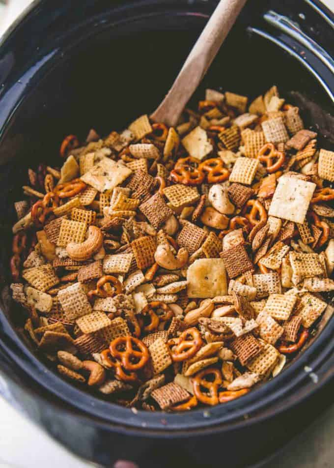 Stirring Ranch Party Mix in the slow cooker