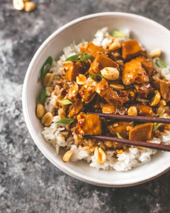 instant pot kung pao chicken over rice with chopsticks