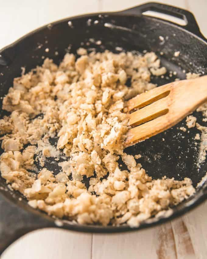 stirring flour and onions in a skillet